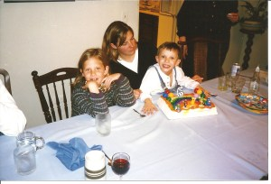 Here's a 1997 version of  the dining room table in a favorite role as birthday party host, co-starring Aunt Cary, Katherine and Vinnie
