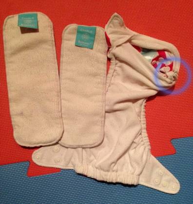 The circle shows where you adjust the elastic. Medium and small inserts shown alongside.