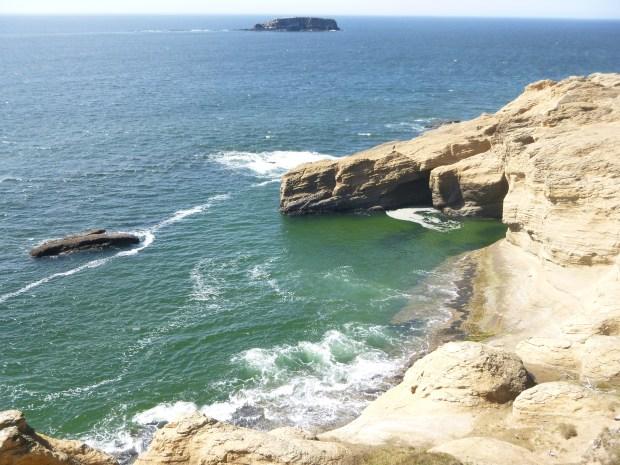 Blue-green waves crash onto rocks, Pacific Ocean, Oregon
