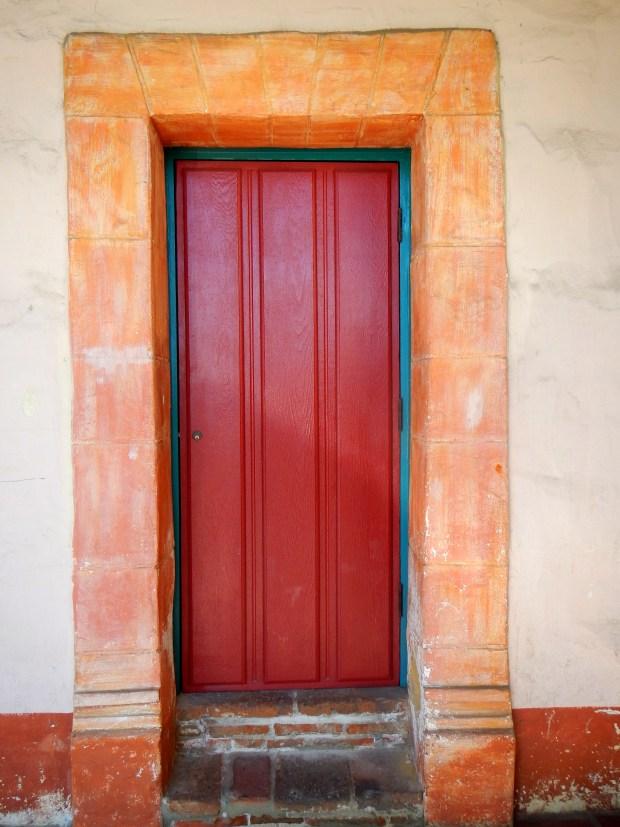 Painted wooden door in quadrangle, Mission Santa Barbara, California