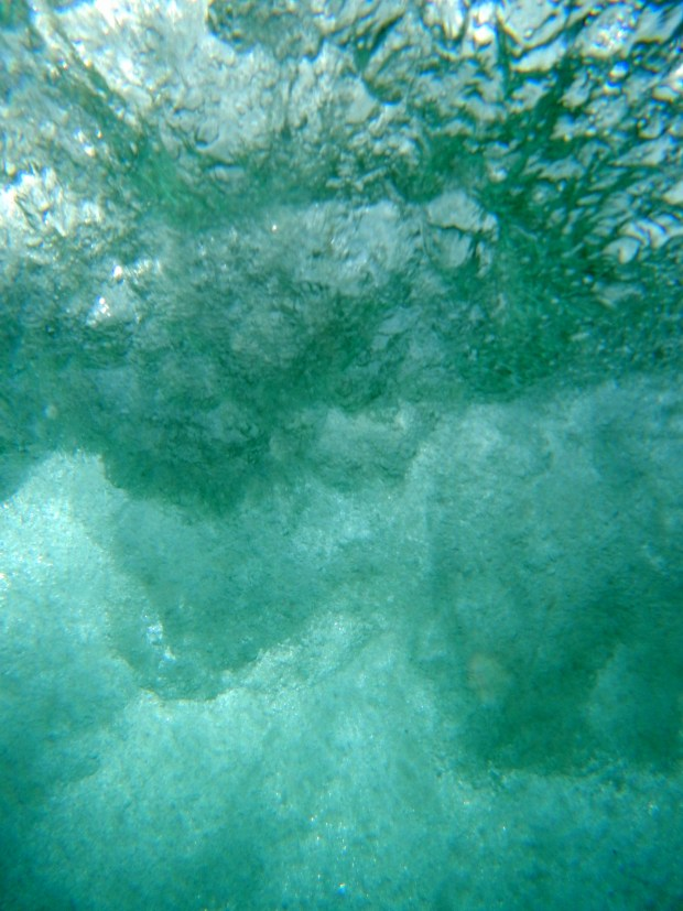 The power of the surf, underwater at Ocean Beach, San Diego, California
