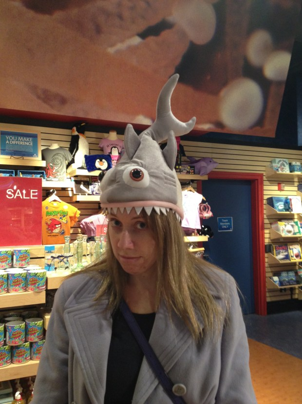 Carrie trying on a hat in the gift shop, Shedd Aquarium, Chicago, Illinois