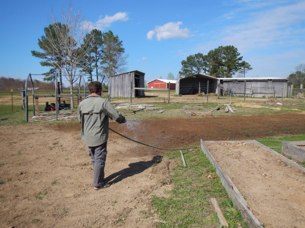 Jonathan watering after planting, Grundy County Community Garden, White City, Tennessee