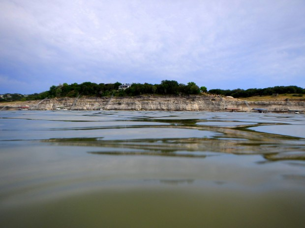 View across the lake from water level, Pace Bend State Park, Lake Travis, Texas