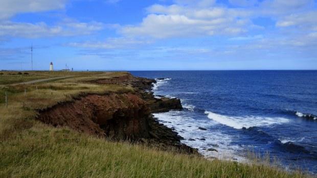 Eroding cliffs and Enragee Point Lightstation, Cheticamp Island, Nova Scotia, Canada