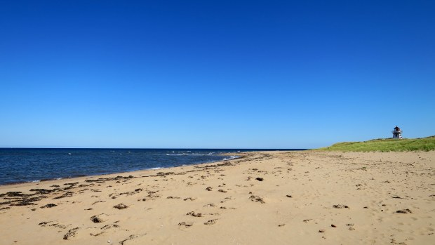 Covehead Harbour Lighthouse from the mouth of the harbor, Brackley-Dalvay, Prince Edward Island National Park, Prince Edward Island, Canada