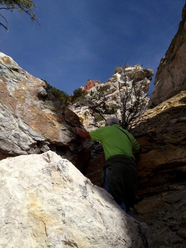 Tom climbing up fallen boulders, Dixie National Forest, Utah