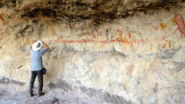 Terry taking photos of the pictographs in Lion's Head, Dixie National Forest, Utah
