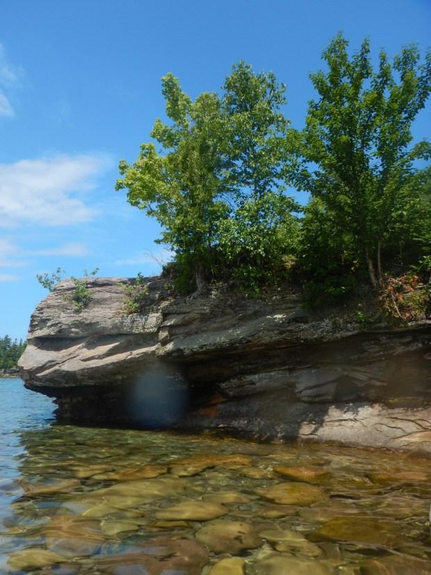 Sandstone ringing the beach, Au Train Bay, Michigan