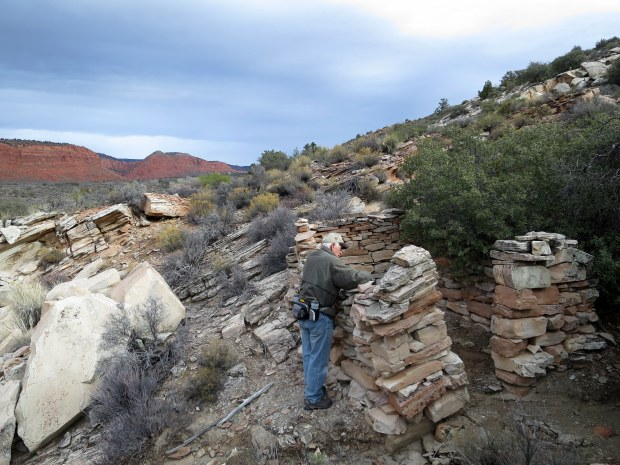Tom looking into a rock house, Red Cliffs National Conservation Area, Utah