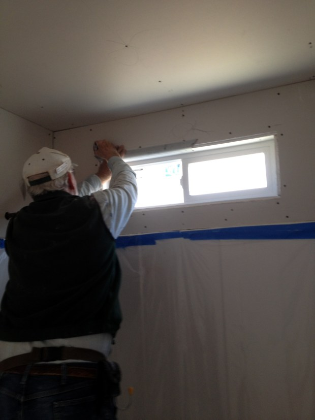 Tony and I screwing in bullnose trim around bathroom window, Mesilla Valley Habitat for Humanity, Las Cruces, New Mexico