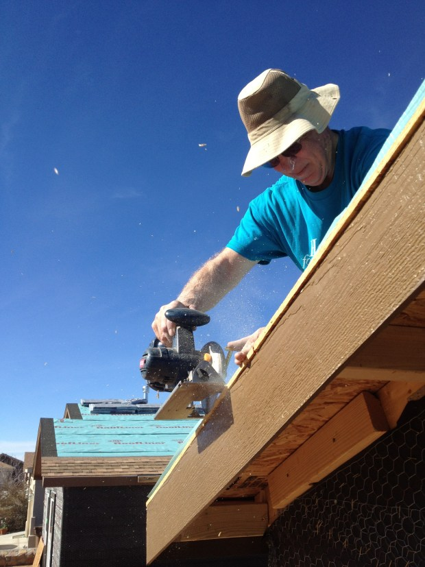 Tony trimming OSB before we install drip edge, Mesilla Valley Habitat for Humanity, Las Cruces, New Mexico