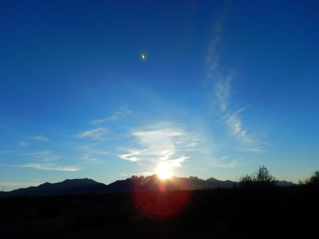 The sun finally pops over the Organ Mountains on the morning dogwalk, Las Cruces, New Mexico