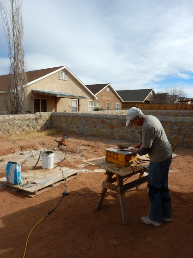Linda wet-sawing tile, Mesilla Valley Habitat for Humanity, Las Cruces, New Mexico