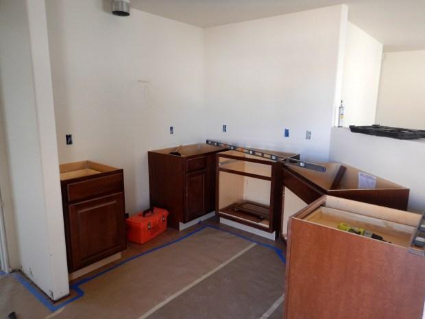 Leveling base cabinets, Mesilla Valley Habitat for Humanity, Las Cruces, New Mexico