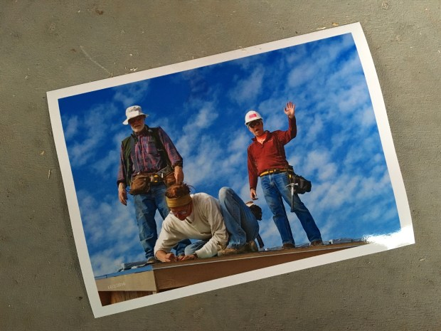 Print of me nailing down a starter shingle with Tony and Doug behind me. Photo taken by volunteer Mac Fell.