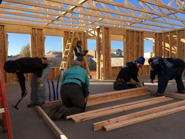 Kathy, Paula, Rick, and Dyana starting an interior wall