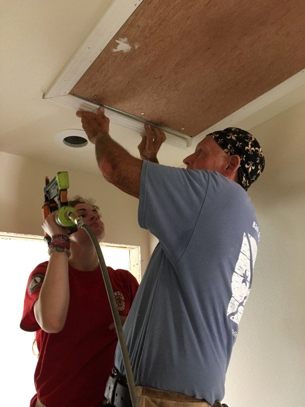 Wes and Americorps volunteer Lauren trimming out the attic access