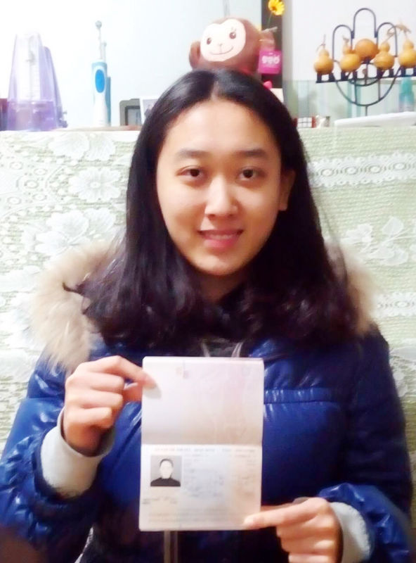 Li-Cheng-Jin-with-passport