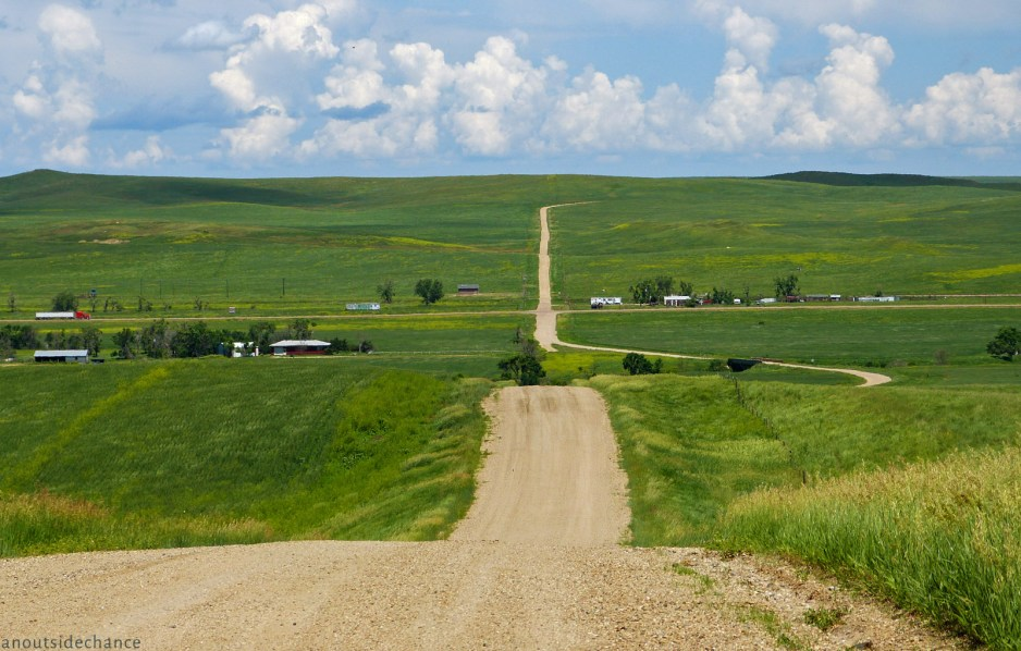 Looking north on County Road 8 near Cottonwood, South Dakota. US 14 runs through the centre of the image from west to east. June 19, 2014.