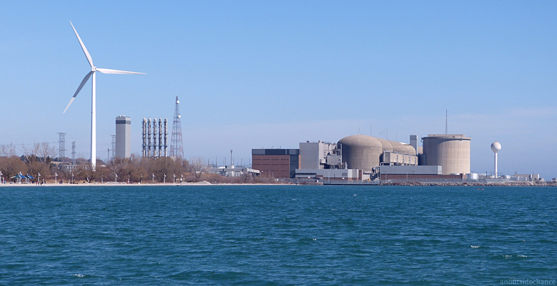 Pickering Nuclear Generating Station and wind turbine, Ontario.