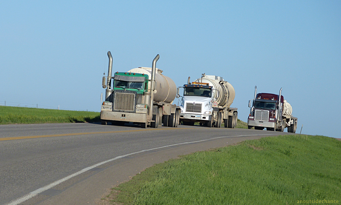 Oil and water trucks  in the Bakken district of North Dakota.