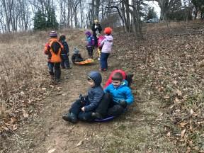 Grass-sledding!