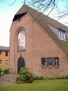 The front of St. Columba's building - a brick built church with a very distinctive shape known as Dutch Barn.