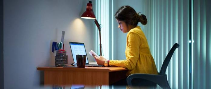 woman studying by a laptop