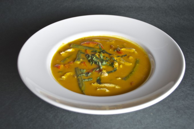 coconut curry squash soup with turkey in bowl