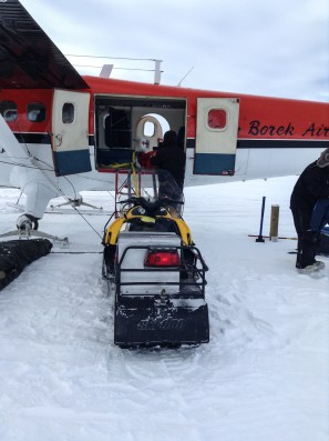 Loading a snowmobile into the Twin Otter