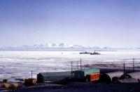 Two ships push through ice.
