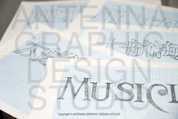 ロゴデザインを細かい方眼紙に落とし込んだ画像
