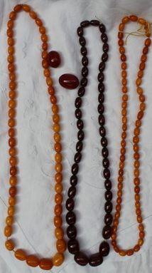 A graduated amber bead necklace, together with another amber necklace with regular beads and a cherry red amber bead necklace. Sold for £1,300 t Anthemion Auctions