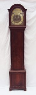 A late 18th / early 19th century mahogany longcase clock the domed hood with fluted pillasters, above a shaped long trunk door, box base and bracket feet. Sold for £880 at Anthemion Auctions