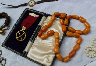 An amber necklace together with a matching bracelet, with cylindrical beads together with a gilt metal Royal Order of the Moose jewel, a braided hair bracelet, a 9ct yellow gold lady's wristwatch and costume jewellery. Sold for £850 at Anthemion Auctions