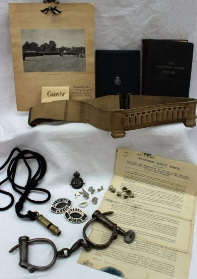 Assorted items relating to The Palestine Police Force including a manual, note book, 1949 calendar, other ephemera, Hiatt handcuffs, webbing gun belt, buttons, badges, whistle etc. Sold for £1,200 at Anthemion Auctions