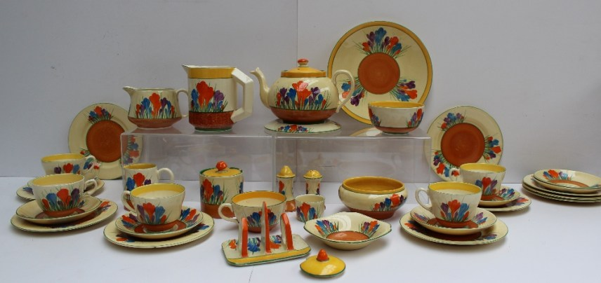 A Clarice Cliff matched Crocus pattern part tea and dessert set. Sold for £780 at Anthemion Auctions