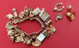 A 9ct yellow gold charm bracelet set with numerous charms including acorn, car, book, camera, miners lamp etc, approximately 67 grams. Sold for £600 at Anthemion Auctions