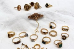 A collection of 9ct gold rings, diamond and semi precious stone set, 9ct gold earrings and a 9ct gold bar brooch set with a ruby and pearls totaling approximately 66 grams. Sold for £580 at Anthemion Auctions