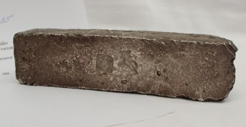 """A silver bar recovered by divers from the wreck of the Dutch East Indiaman """"Bredenhof"""". Sold for £1,350 at Anthemion Auctions"""