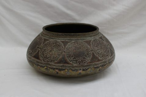 An Anglo-Indian brass, copper and white metal mounted shallow bowl. Sold for £950 at Anthemion Auctions