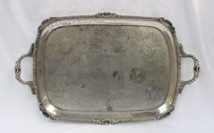 A late Victorian silver twin handled tray with a gadroon and shell border. Sold for £1,200 at Anthemion Auctions