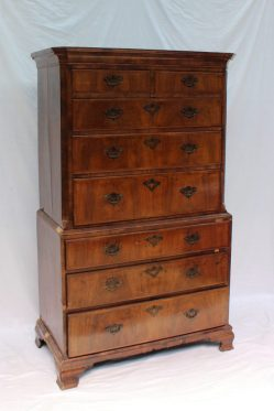 An 18th century walnut chest on chest, the moulded cornice above two short and three long drawers enclosed between canted corners, the base with three long drawers on bracket feet, 102.5cm wide x 166.5cm high . Sold for £950 at Anthemion Auctions