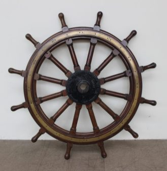 "A large brass and hardwood ships wheel, with twelve spokes, the cast plate to the centre inscribed ""Stephens - Adamson Mfg co of Canada Ltd Belleville Ontario"". Sold at Anthemion Auctions for £780"