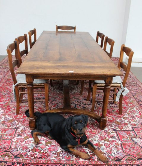 An 18th century oak refectory table with a set of eight ladder back chairs. Sold for £600 at Anthemion Auctions