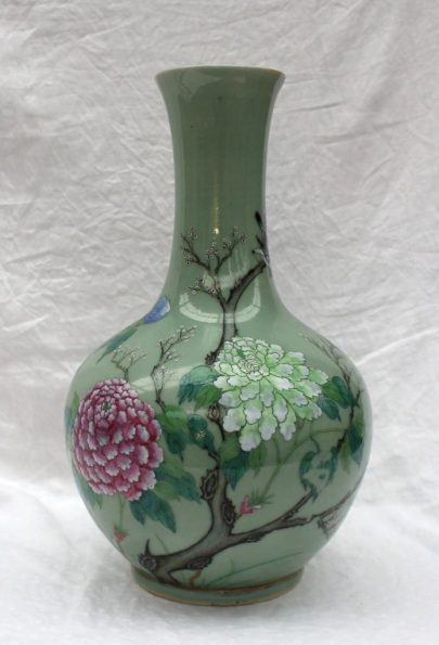 A large Chinese celadon vase with raised floral decoration in pinks, blues and greens, six character Qianlong mark to the base 39.5cm high. Sold for £1,550 at Anthemion Auctions
