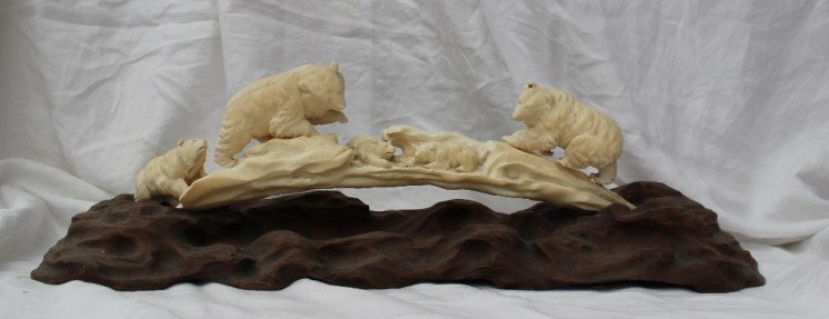 A late 19th century ivory figure group depicting bears and bear cubs on a naturalistic carved ivory arch and on a carved base. Sold for £1,050 at Anthemion Auctions