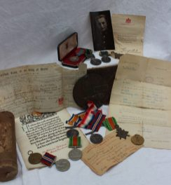 Three World War I medals, including The British War Medal, Victory Medal and 1914-15 star, death plaque and ephemera relating to 2637 PTE. William Mahoney, R.W. Fus. Sold for £850 at Anthemion Auctions