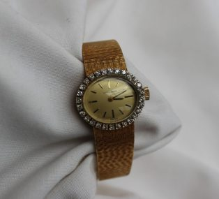A Lady's yellow gold and diamond set Longines wristwatch. Sold for £720 at Anthemion Auctions